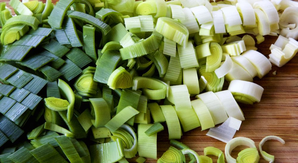 Diced leek, showing a colour gradient from dark green to almost white.