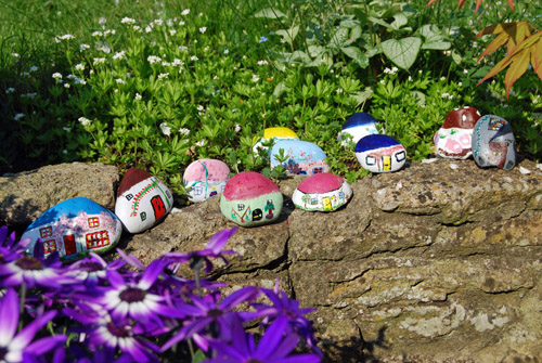 Stone Craft Fairy Village on a garden wall.