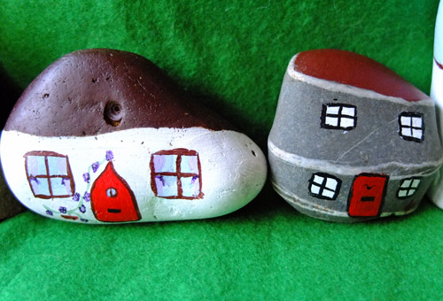 Painted stone houses with detailed windows and doors.