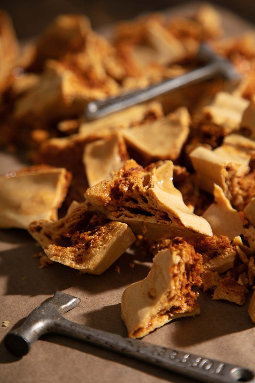 Honeycomb pieces with two toffee hammers.