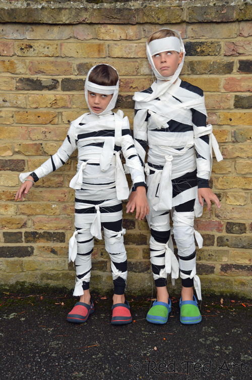 Two boys dressed as mummies for halloween.