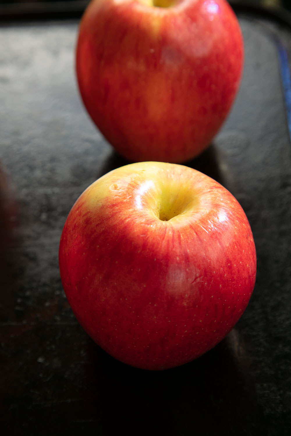 Red Apples on a baking tray.