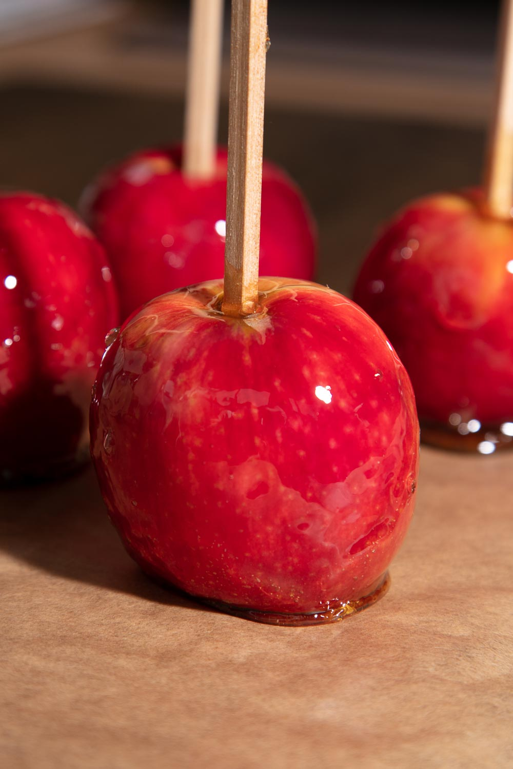 Shiny red toffee apples.