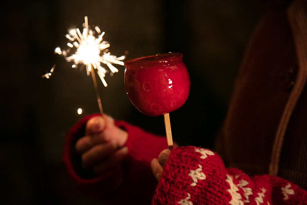 Red toffee apple and sparkler.