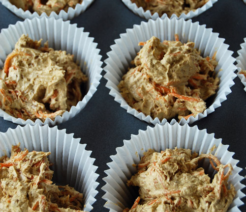 Carrot bun mix in cupcake cases, ready to go in the oven.