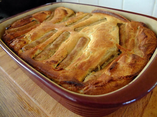 Vegetarian toad in the hole in an earthenware dish.