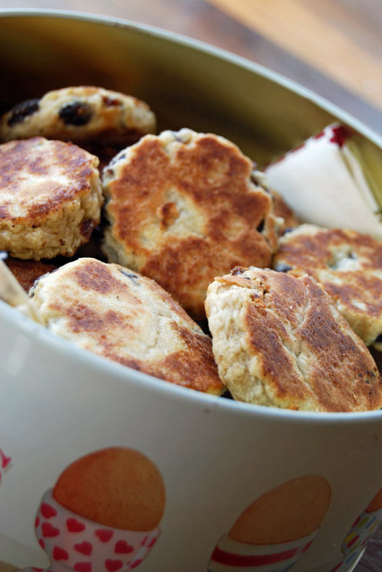 A pile of Welsh cakes in a tin.