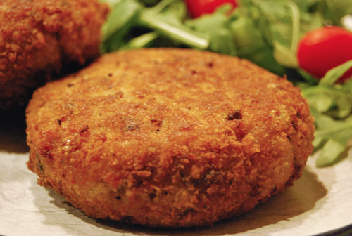 Wild mushroom risotto cakes with salad.