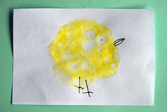 Very round chick painted with bubbles, with pen used to add the beak, eye and legs.