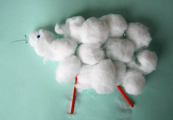 Cotton wool balls glued to paper to make a lamb.