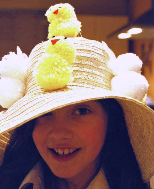 Young girl wearing the finished bonnet.