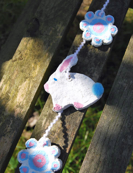 Cornflour bunny and flowers tied together with string.
