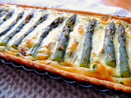 Asparagus Quiche in a rectangular tart dish.