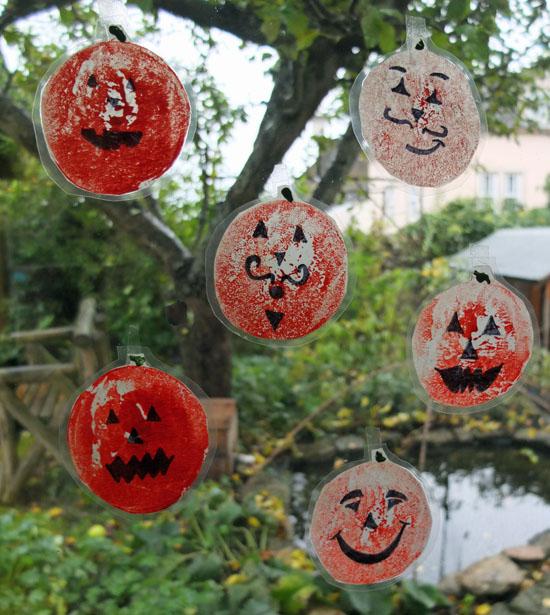 Laminated prints with hand-drawn pumpkin faces.