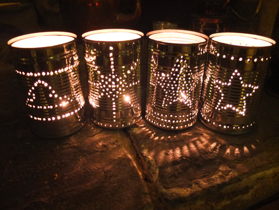 Christmas lanterns made from food tins.