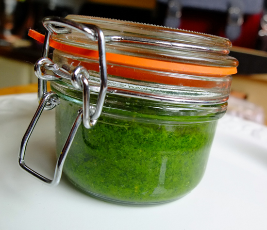 A jar of bright green nasturtium pesto