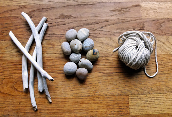 Driftwood sticks, pebbles and twine.