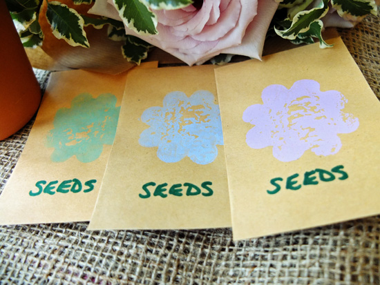 Homemade seed packets, with a flower printed on the front.