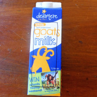 Milk carton with a rectangle marked out for cutting.