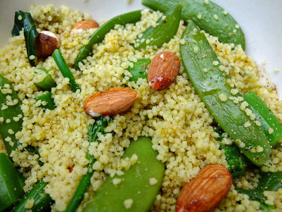 Couscous salad with almonds, sugar snap peas and tenderstem broccoli.