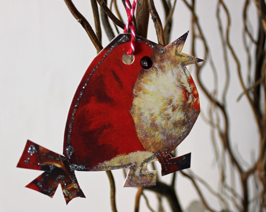 Christmas Robin, cut out from an image of Father Christmas and outlined with silver glitter.