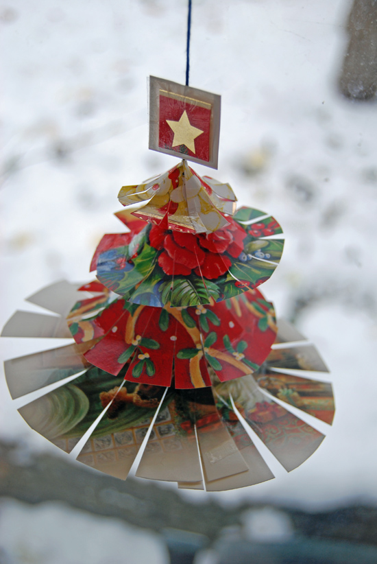 Small christmas tree made from cards.
