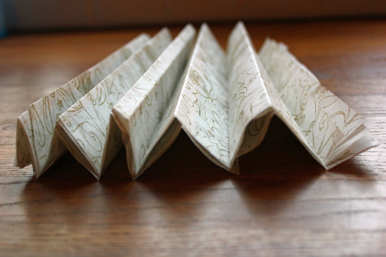 Tissue paper folded into a zigzag.