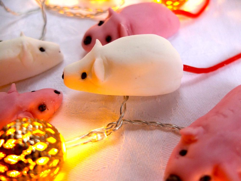 Pink and white sugar mice with strawberry bootlace tails.