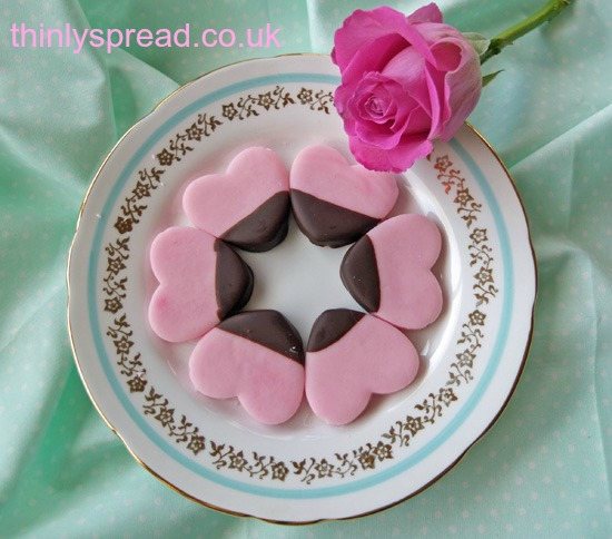 Pink valentine's heart creams on a decorative plate.