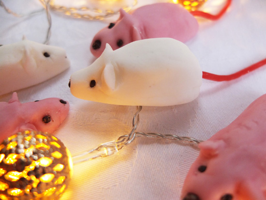 White and pink sugar mice with strawberry bootlace tails.