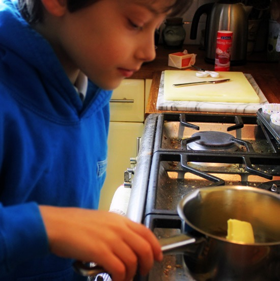 Melting butter in a pan on the stovetop.
