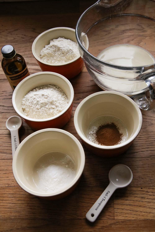 Ingredients for vegan pancakes in bowls, ready to make batter.