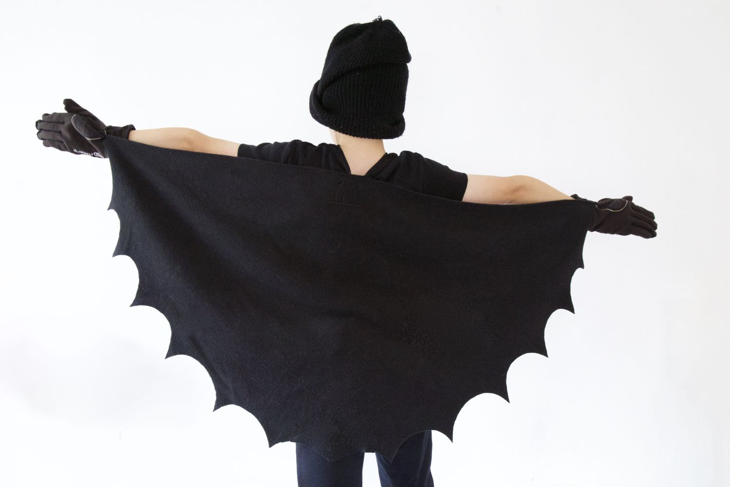 Young boy wearing Halloween Bat wings.