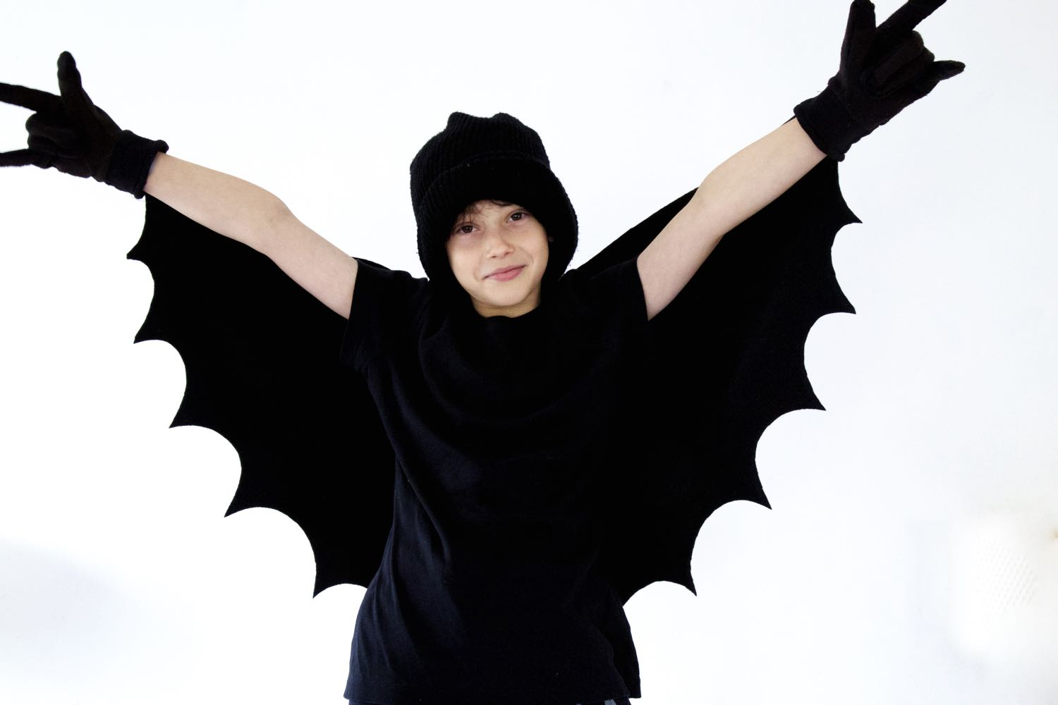Boy dressed as a Halloween Bat.