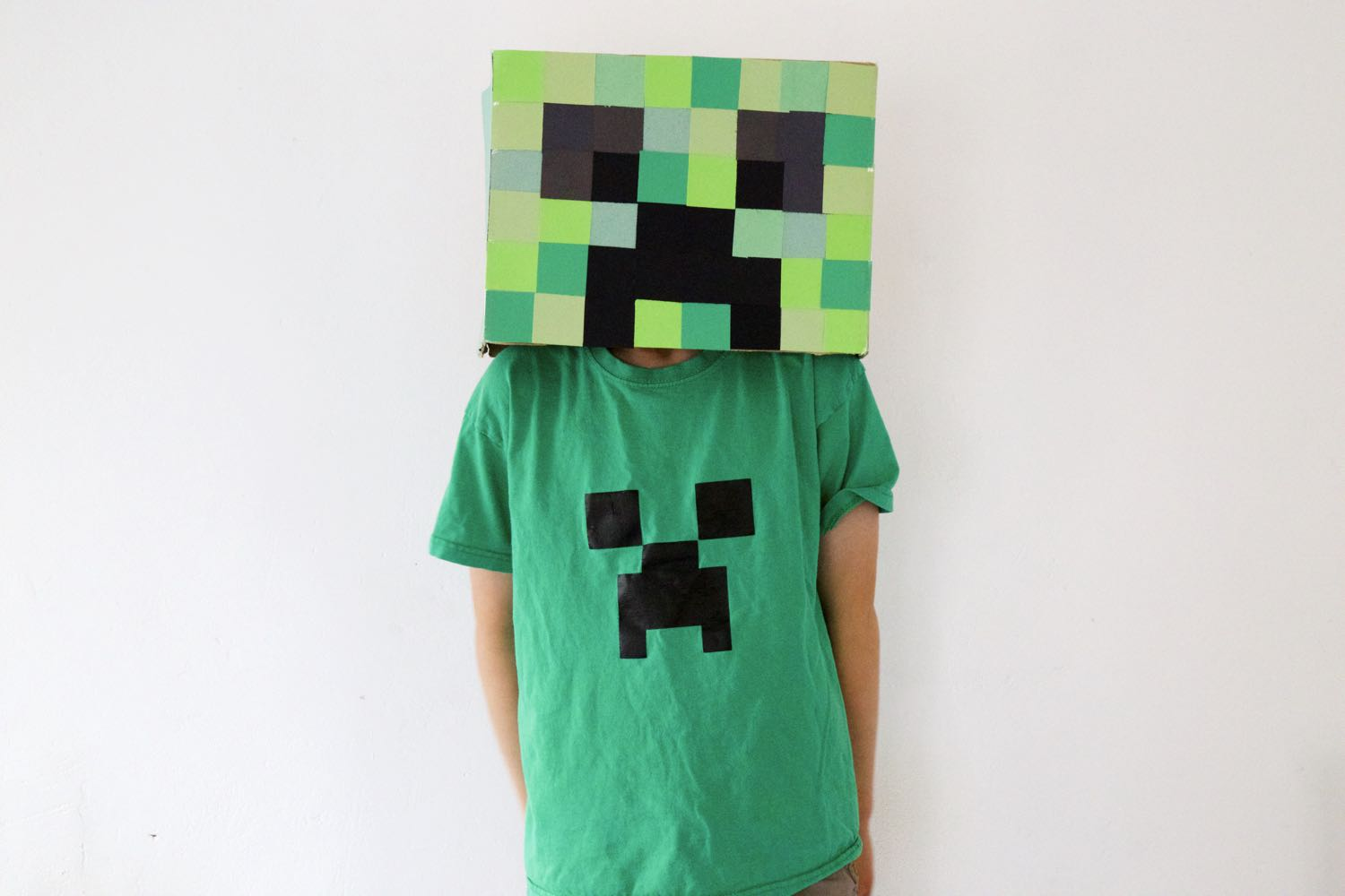 Halloween Creeper head worn with a green creeper shirt.