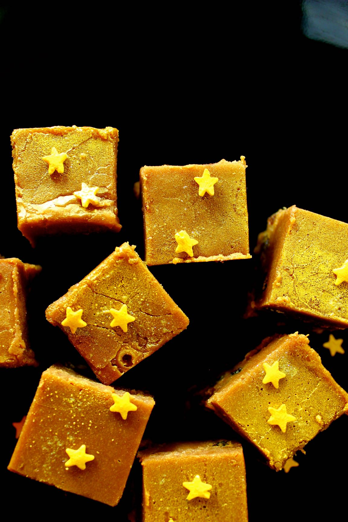 Fudge topped with sugar stars and sprayed with edible glitter.