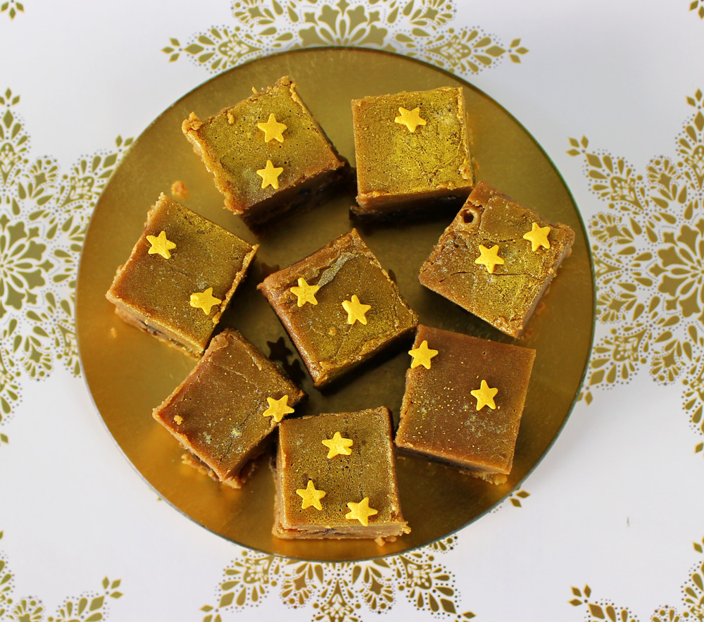 Christmas fudge on a metal plate, topped with yellow sugar stars.