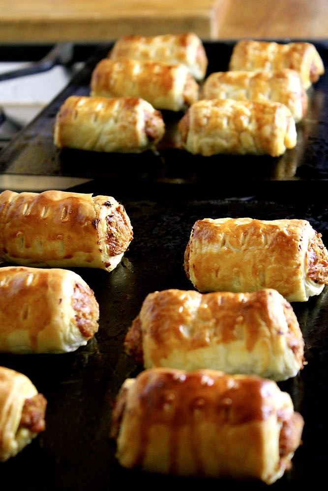 Finished sausage rolls on baking trays.