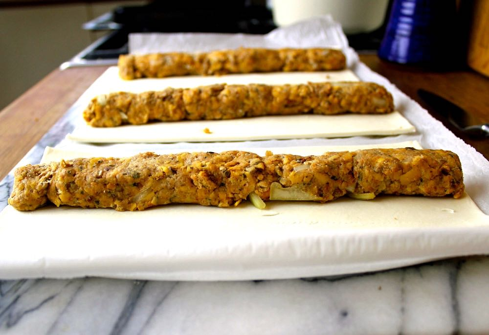 Sausage roll mix on pastry, ready to be rolled up.