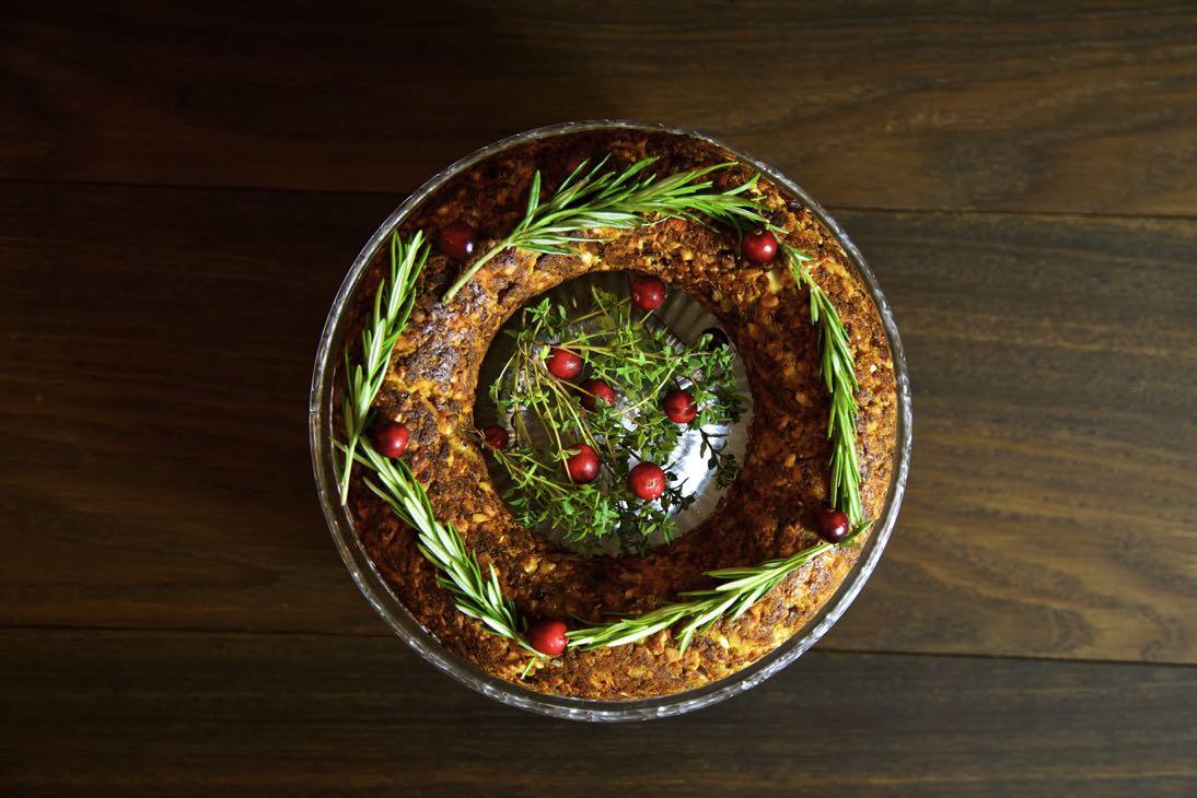 Vegan Christmas Roast on a glass cake stand.