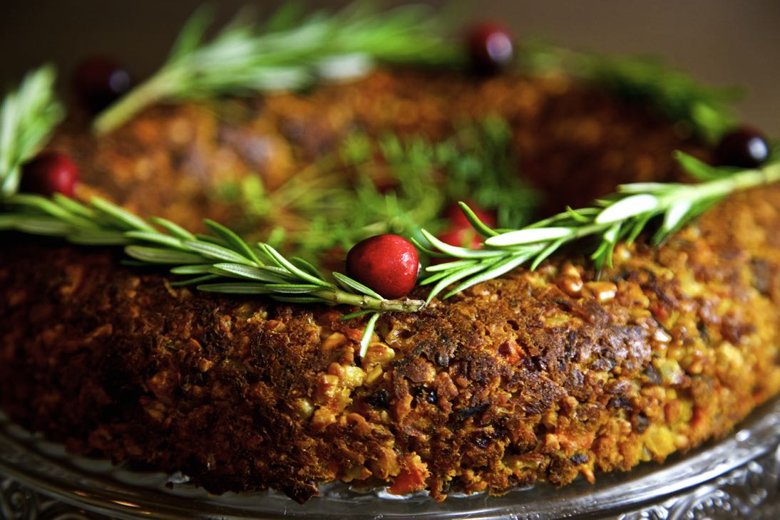Vegan Christmas Roast ring with cranberries and rosemary.