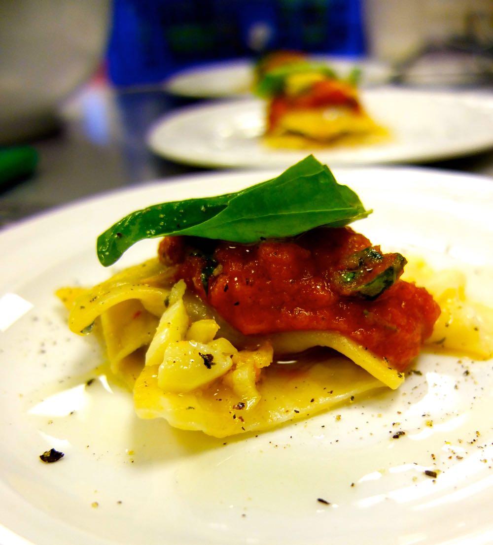Vegan Ravioli topped with fresh tomato sauce.