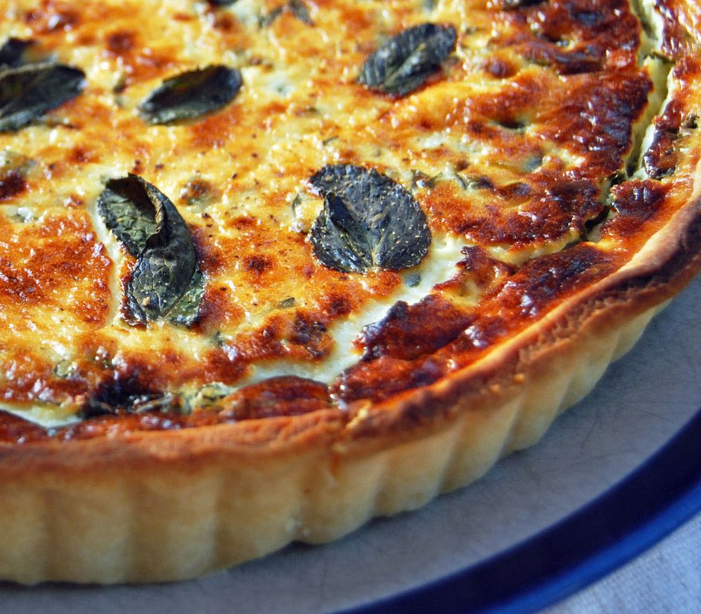 Goats' cheese tart with mint and shortcrust pastry.
