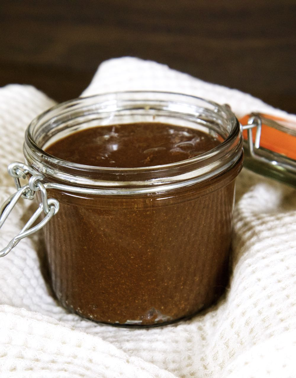 Homemade vegan Nutella in a glass jar.