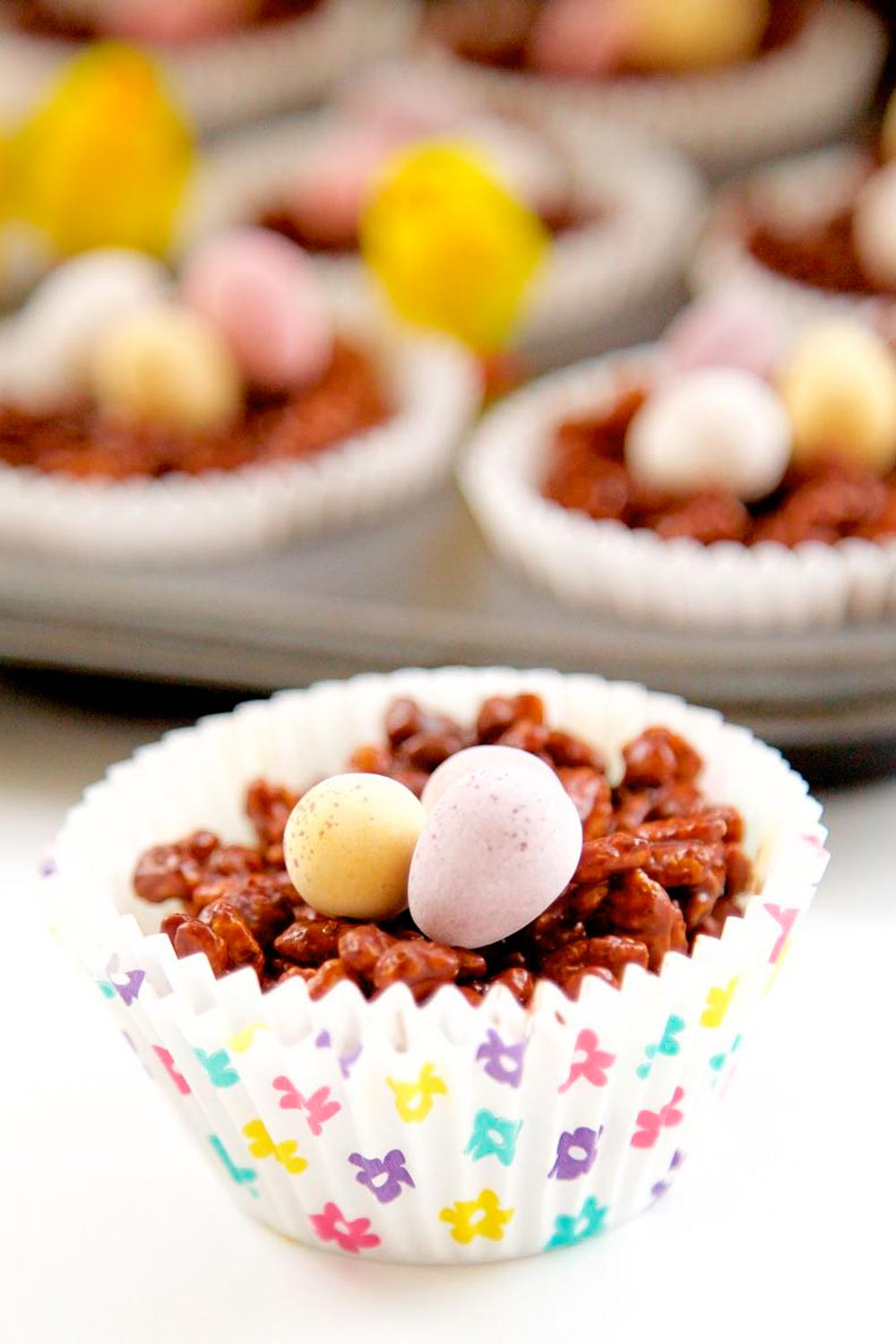 Chocolate Rice Krispies Cake in a spring muffin case, topped with mini eggs.