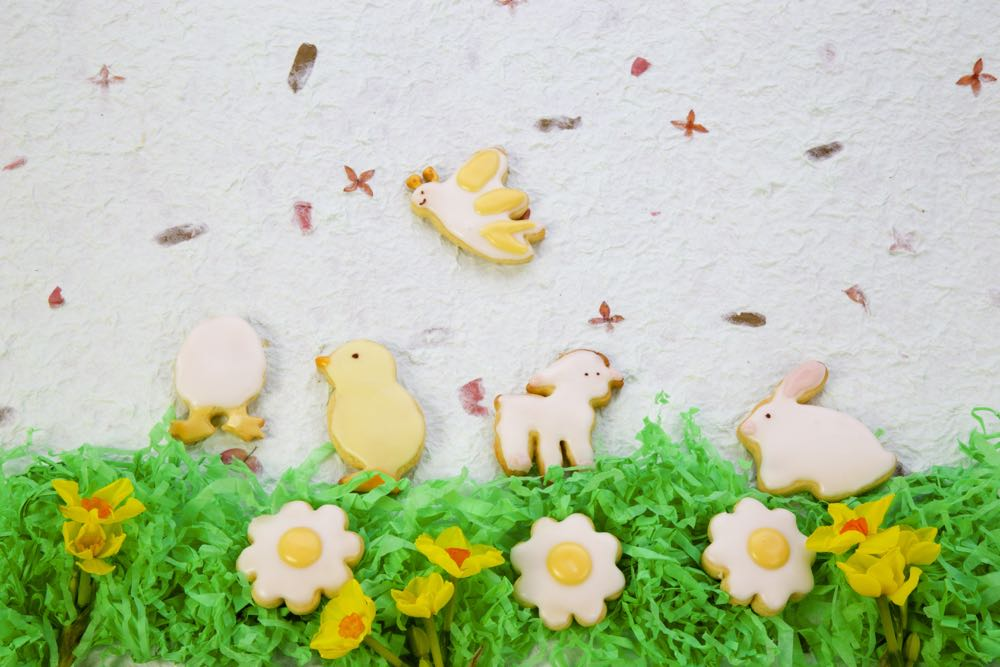 Iced Spring Biscuits for easter, arranged in a field scene.