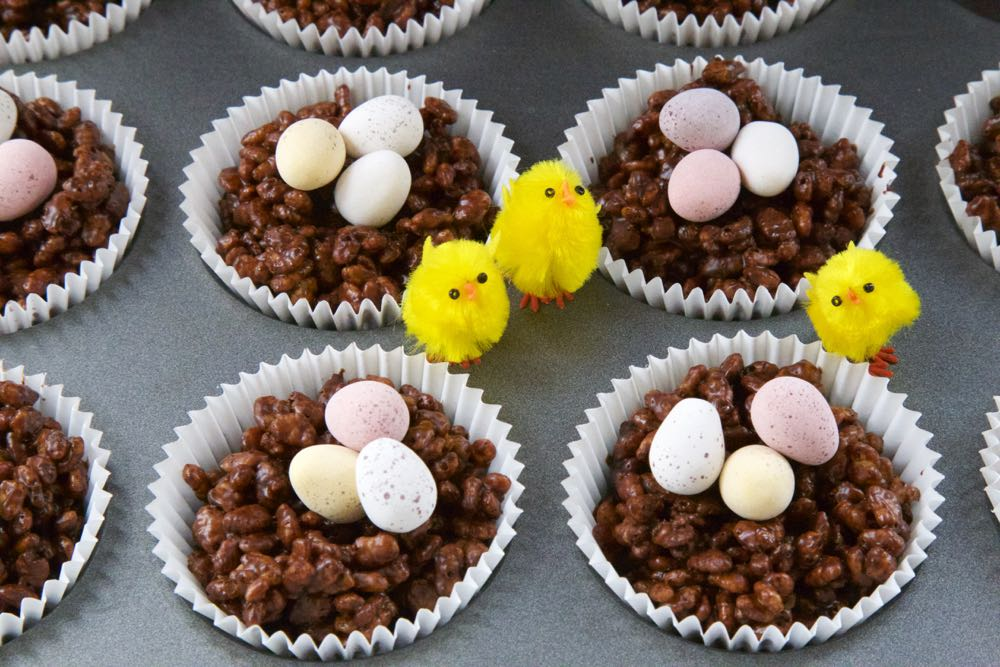 Easter Nest cakes with chocolate eggs and tiny toy chicks.