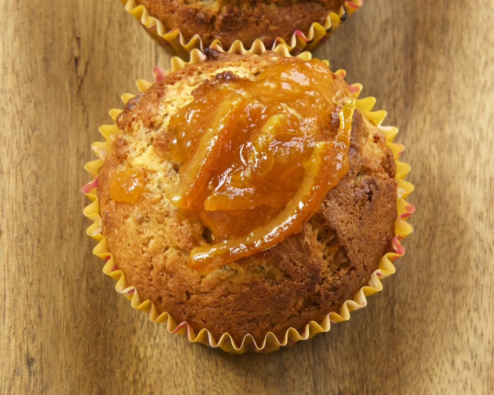 Marmalade muffins topped with extra marmalade.