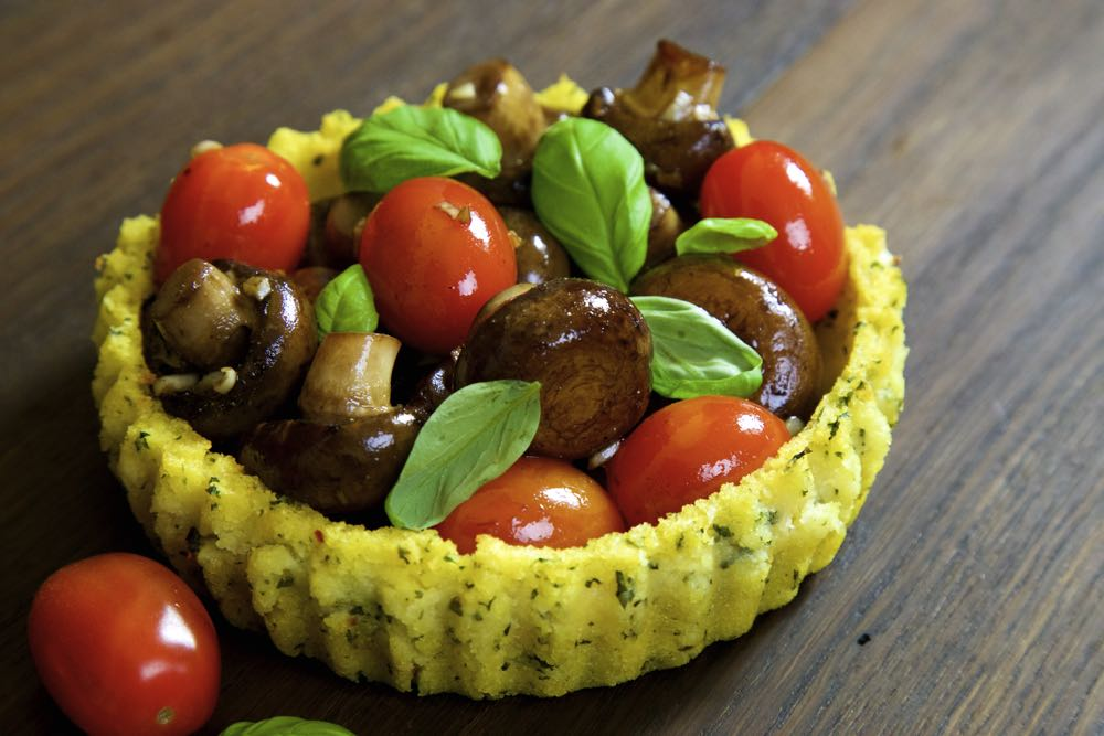 Polenta Baskets stuffed with garlic mushrooms and baby plum tomatoes with black pepper, balsamic vinegar and basil.
