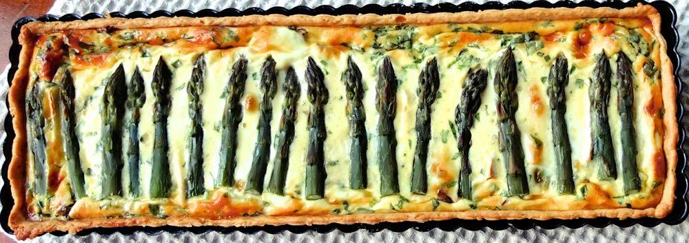 Asparagus quiche in a rectangular pie tray.
